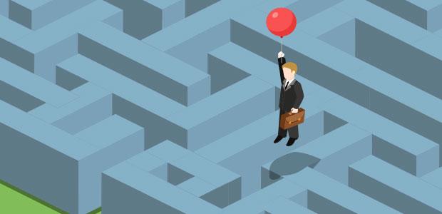 Man using ballon to escape a maze